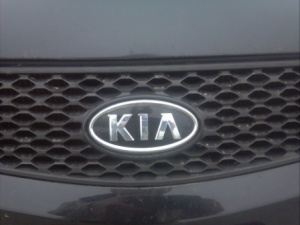 KIA badge.