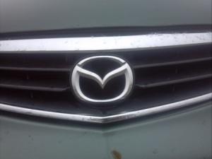 Mazda badge.
