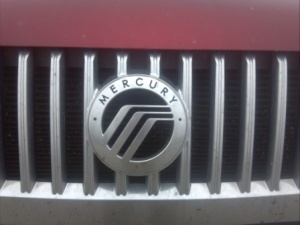 Mercury badge.