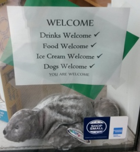 Welcoming sign on store